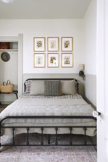 small vintage bed in corner with beadboard