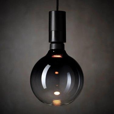 black lighting fixture with black light bulb
