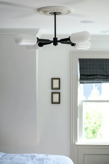 semiflush light fixture on white ceiling in small bedroom