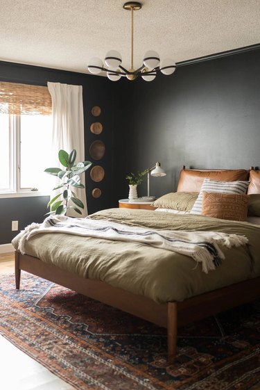 black small bedroom with wall baskets