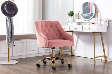 Peach tufted office chair with gold base