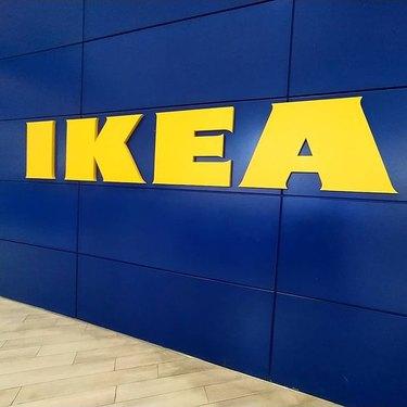 ikea logo on blue wall