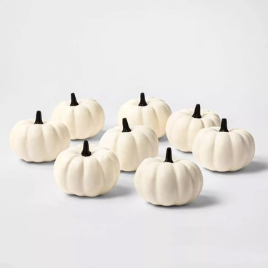set of white painted pumpkins
