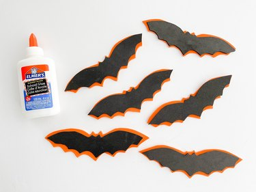 Glue the cut bat shapes on top of each other.