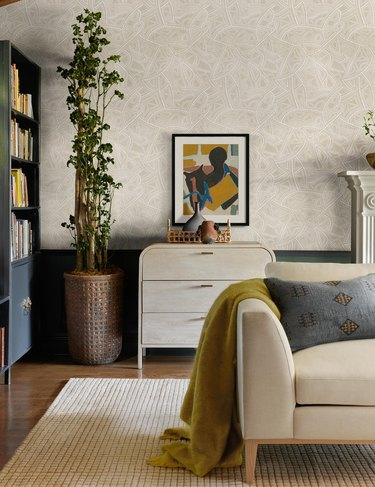 living room with patterned wallpaper