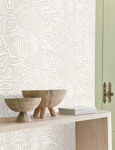 patterned wallpaper with console and bowls