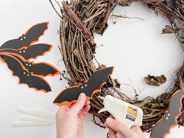 Glue the bat shapes to your wreath form.