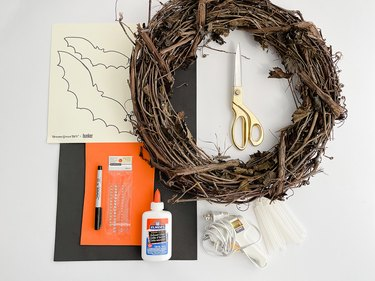 Here's what you'll need to make your DIY Halloween Bat Wreath.