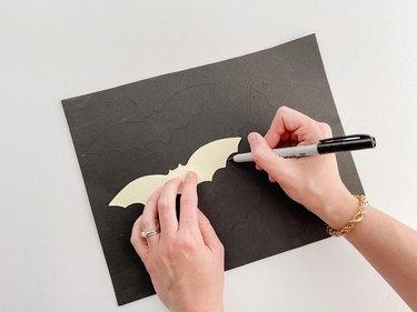Trace the bat template onto black foam.