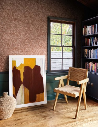 patterned wallpaper with artwork and chair