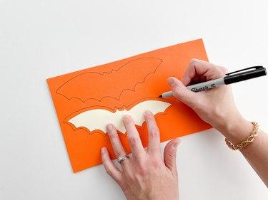 Trace the bat template onto orange foam.