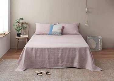 Bed with blush sheets