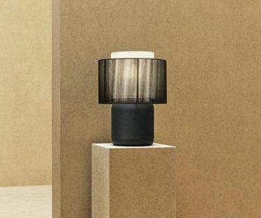 black IKEA symfonisk table lamp on a pedestal