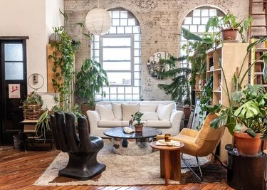 This Funky Living Room Proves We All Need a Hand-Shaped Statement Chair