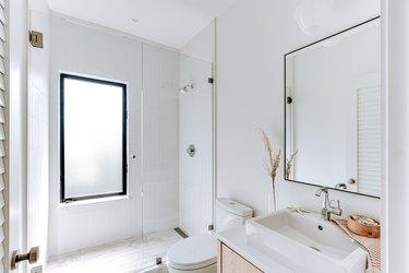 walk in shower obscure glass window pane