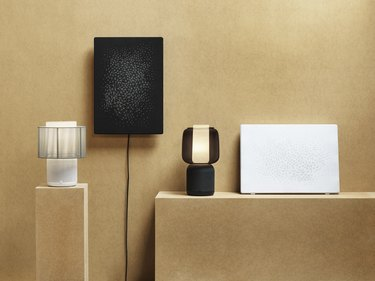 black and white IKEA sound products on the wall and on pedestals