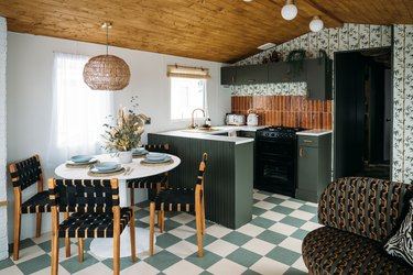 renovated caravan with Palm Spring inspired kitchen with bamboo blind