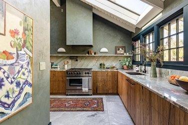 walnut kitchen with industrial windows