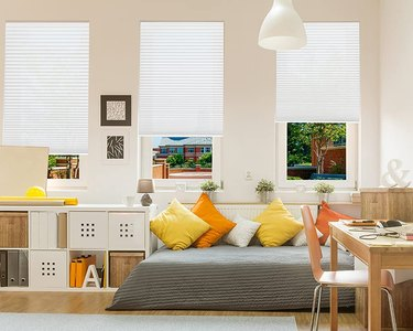 Pleated shades in a colorful living room