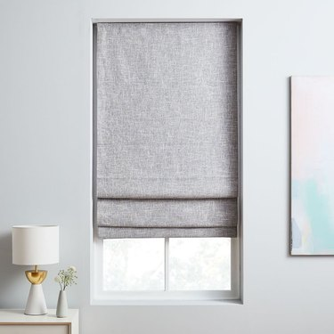 Linen roman shades over a window