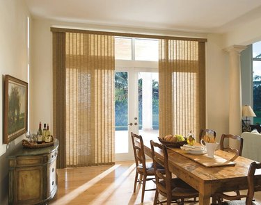 Fabric vertical blinds in a dining room
