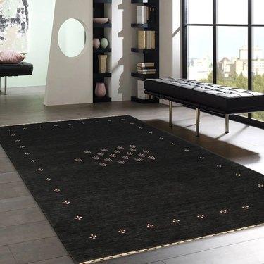Black silk patterned rug