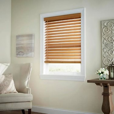 Wood blinds hung in a living room