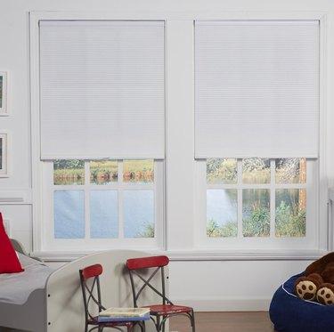 Semi-sheer cellular shades in a kid's bedroom