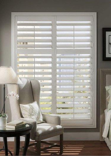 Interior louvered shutters in a bedroom