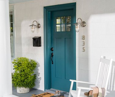 front porch with teal door