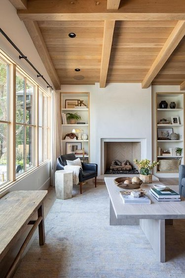 neutral living room with cross beam wood ceiling