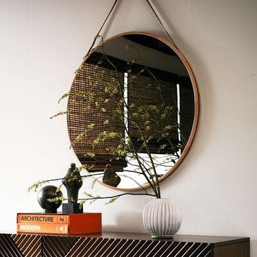 Hanging circle mirror on faux leather string