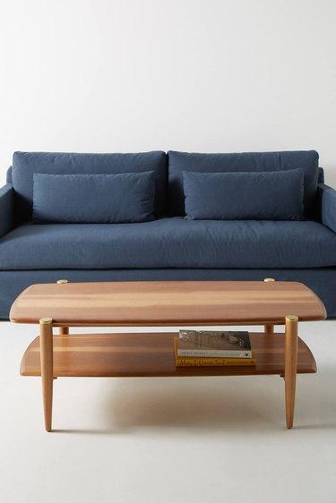 Minimal wood rectangular midcentury coffee table with lower shelf
