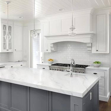 White kitchen with painted marble countertops