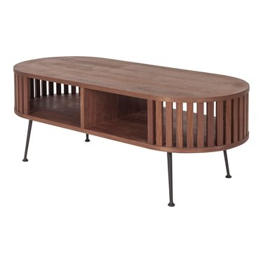 Long oval coffee table with vertical slates on sides and two open shelves