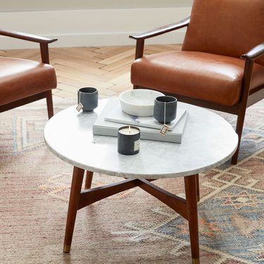 Small round coffee table with white marble top and wood legs