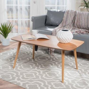 Minimal wood midcentury coffee table in medium finish