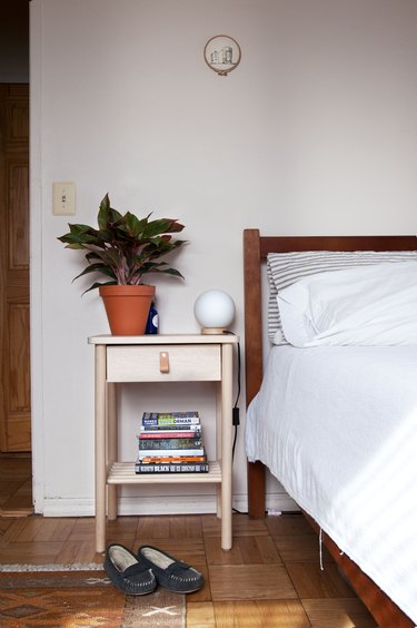 Plant on a bedside table in bohemian living room