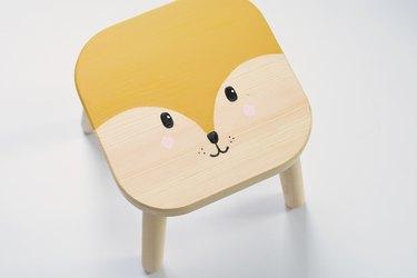 Kid's wood stool with painted cartoon fox face