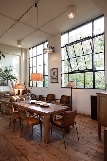 a solid wooden dining table and brown leather chairs