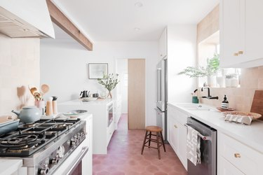 white and wood contemporary kitchen with white cabinets