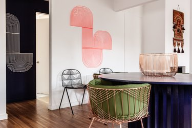 pink room ideas with pink abstract art, rose gold chair with green cushion.