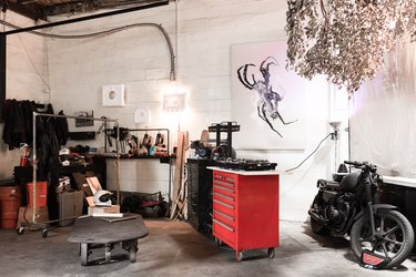 Loft with large red tool storage cabinets