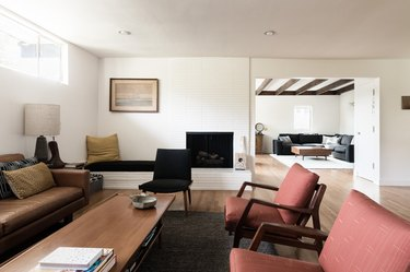 Midcentury living room with couch and chairs