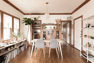 eco-friendly home design with minimalist dining room with a wooden table, pendant lamp and grey Eames chairs