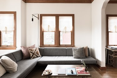 grey couch and cushions in a minimalist living room