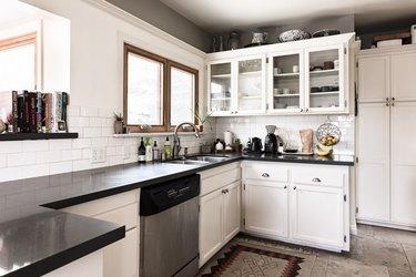 Modern kitchen with white backsplash
