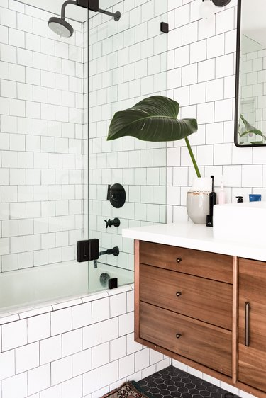 Tiled shower with plants in modern bathroom