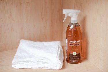 method cleaner spray with white towel