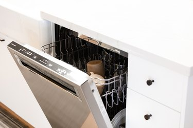 open dishwasher in white kitchen